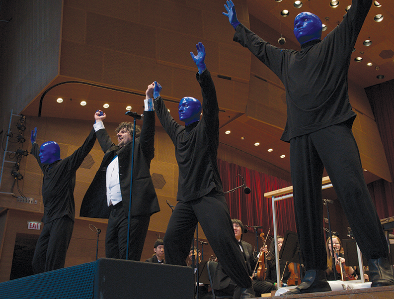 Allen Tinkham takes a bow with members of Blue Man Group at CYSO's performance at Grant Park Music Festival, June 2014.