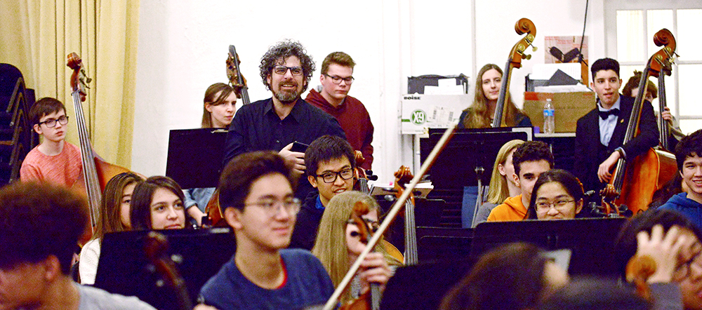 Maestro Allen Tinkham and members of Symphony Orchestra look on as Sir Andrew Davis conducts rehearsal