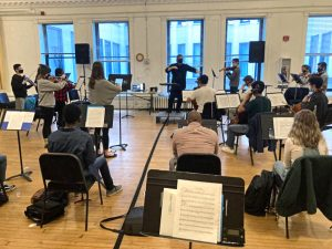 Symphony Orchestra pod rehearsal photo by Louis Auxenfans