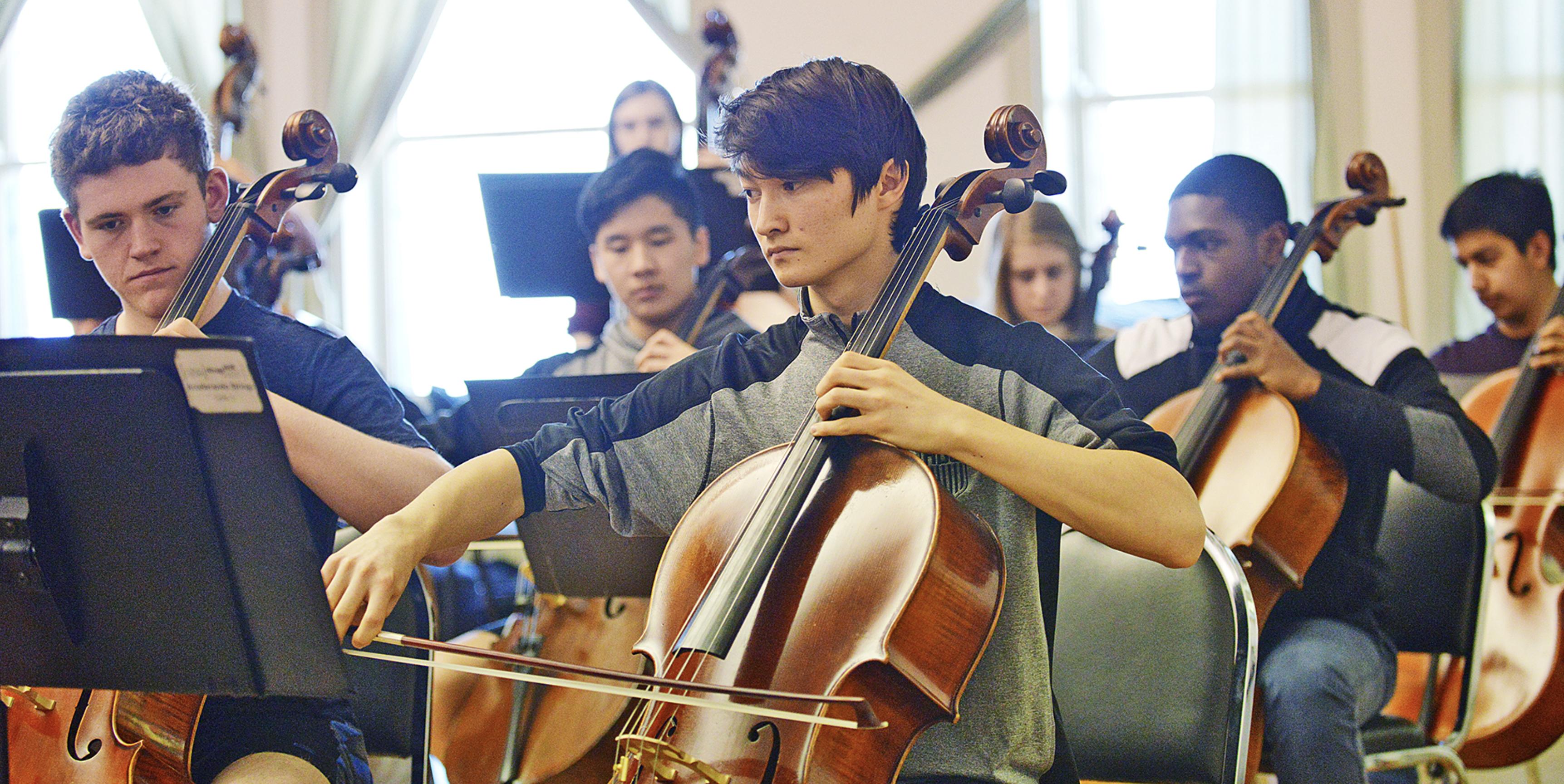Accelerando Strings cellists rehearsing