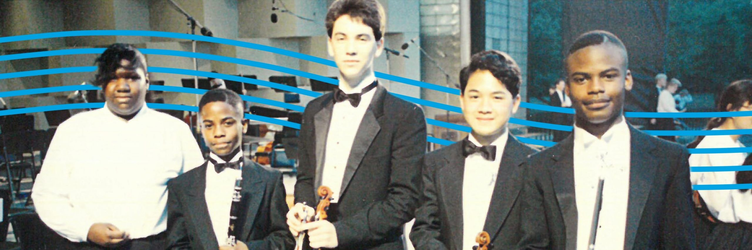 Five teenage musicians, dressed formally for a concert, holding their instruments