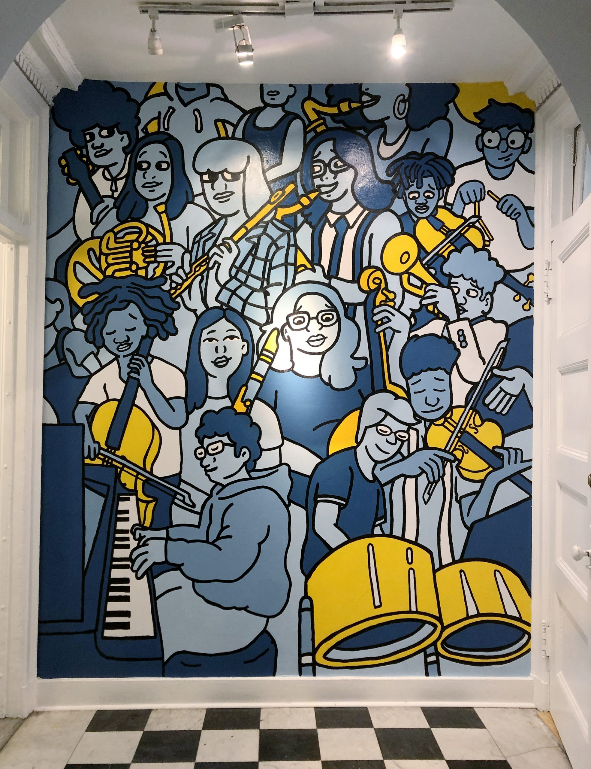 Photo of CYSO's completed mural featuring cartoon images of young musicians